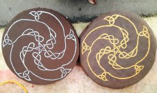 Two painted fabric shields, made 3 years apart,
