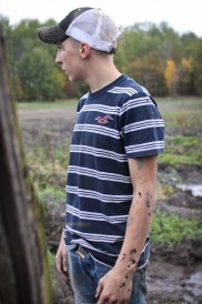 Logan Douglas, age 16, waits for his Step Father, Doug Jarman to come tow him out of a mud pit in Farwell, Mich. on Friday Oct. 4, 2013.