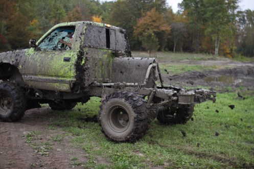 Logan Douglas, age 16, pulls out of a mud pit shooting mud off his tires in Farwell, Mich. on Friday Oct. 4, 2013.