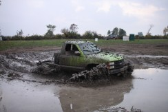 Logan Douglas, age 16, drives through a mud pit in Farwell, Mich. on Friday Oct. 4, 2013.