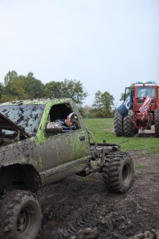 Logan Douglas, age 16, gets towed out of a mud pit by his Step Father, Doug Jarman in Farwell, Mich. on Friday Oct. 4, 2013.