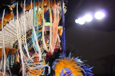 A judge watches dancers compete at the 25th Annual Celebrating Life Pow Wow in McGuirk Arena Sunday, March 23, 2014.