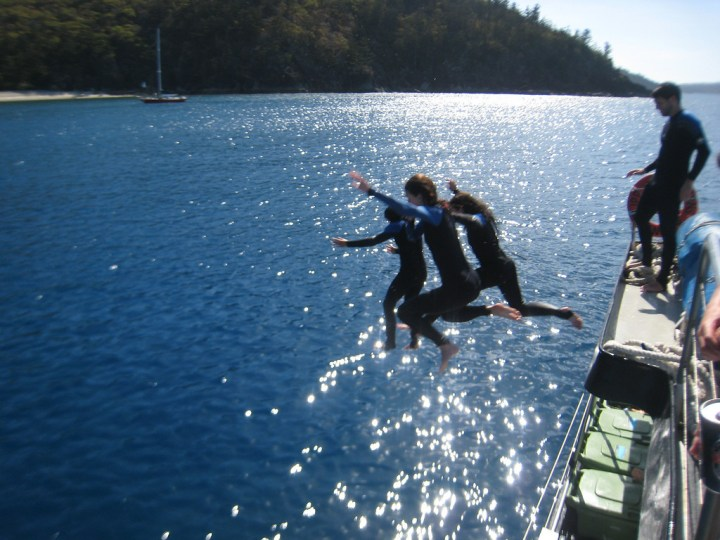 Jumping off of boat in Whitsunday Islands