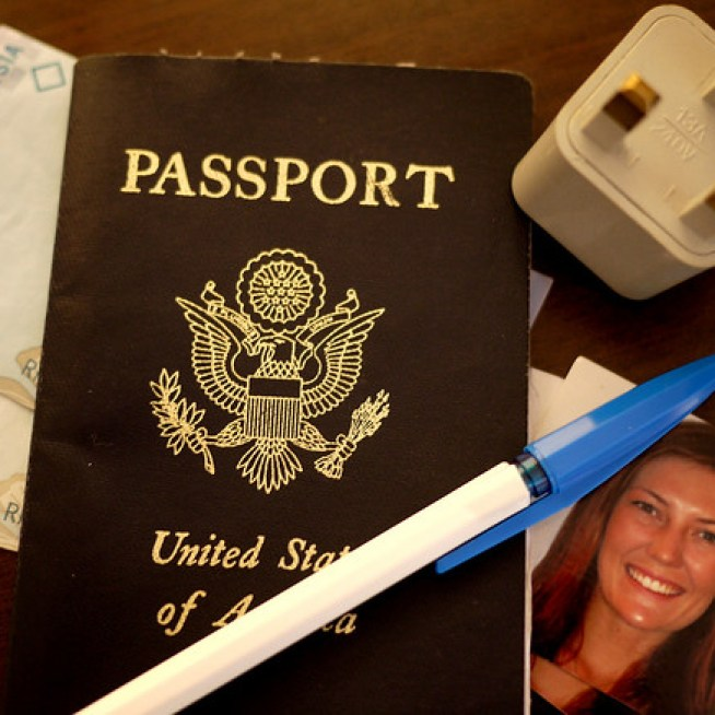 Tools for a visa run: Passport, money, converter, photos, and a pen!