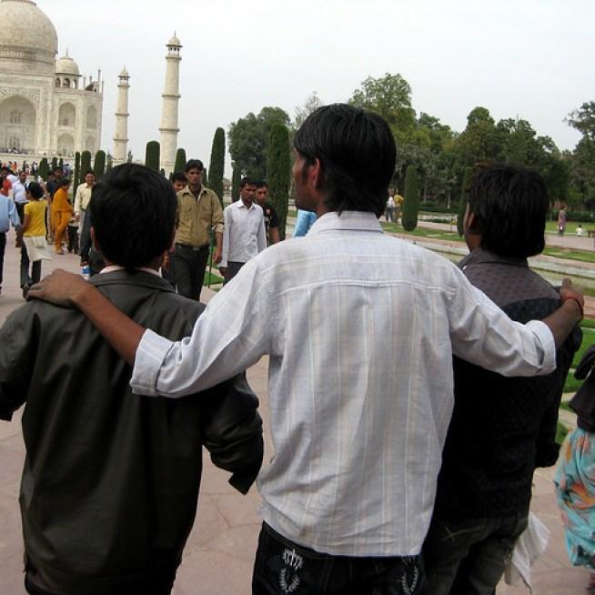 Friends visit the Taj Mahal, India.