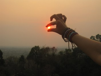Pinching the sun on the towers of Angkor Wat