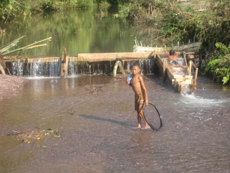 watering hole in laos village