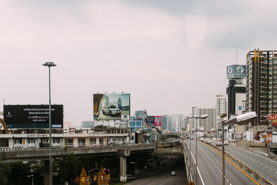 Urban decay, traffic & buildings in Thailand.