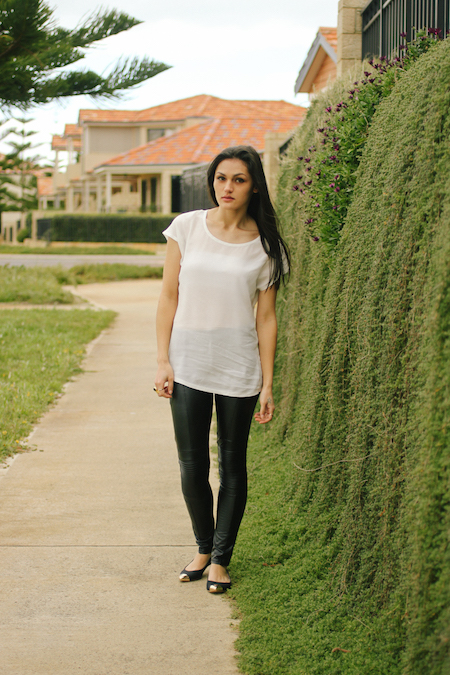 Leather pants & white silk tee outfit.
