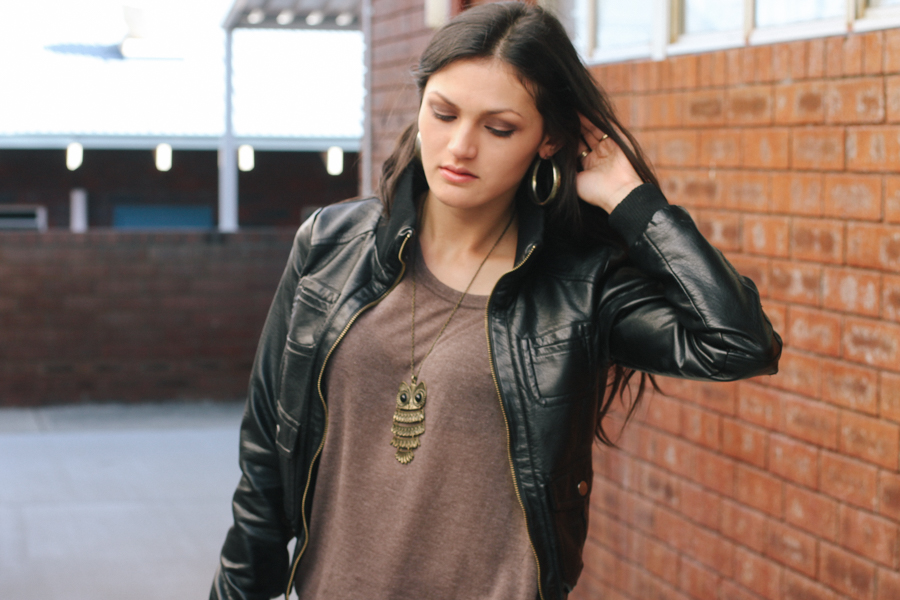 Perth fashion blogger wearing black leather look jacket, brown top & owl necklace.