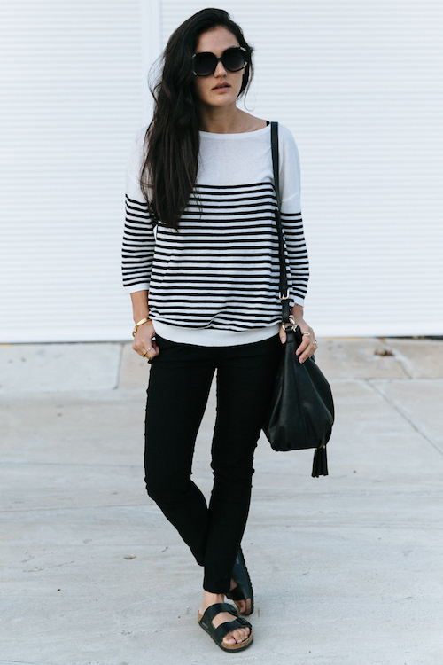 Black pants with stripe sweater outfit.