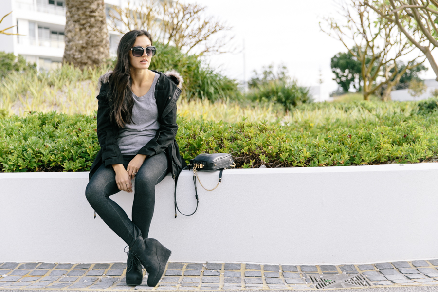 Fur hood anorak parka jacket with jeggings & wedge ankle boots outfit.