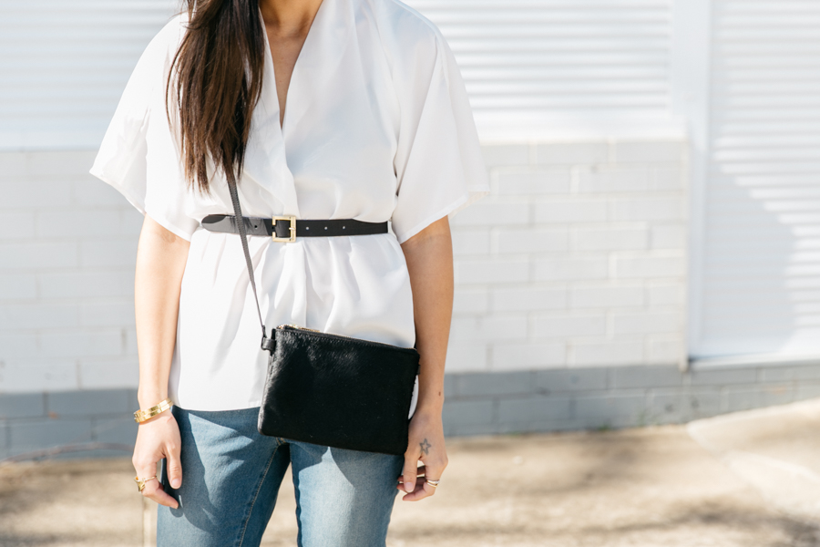 Australian fashion blogger in monochrome outfit, minimalist style.