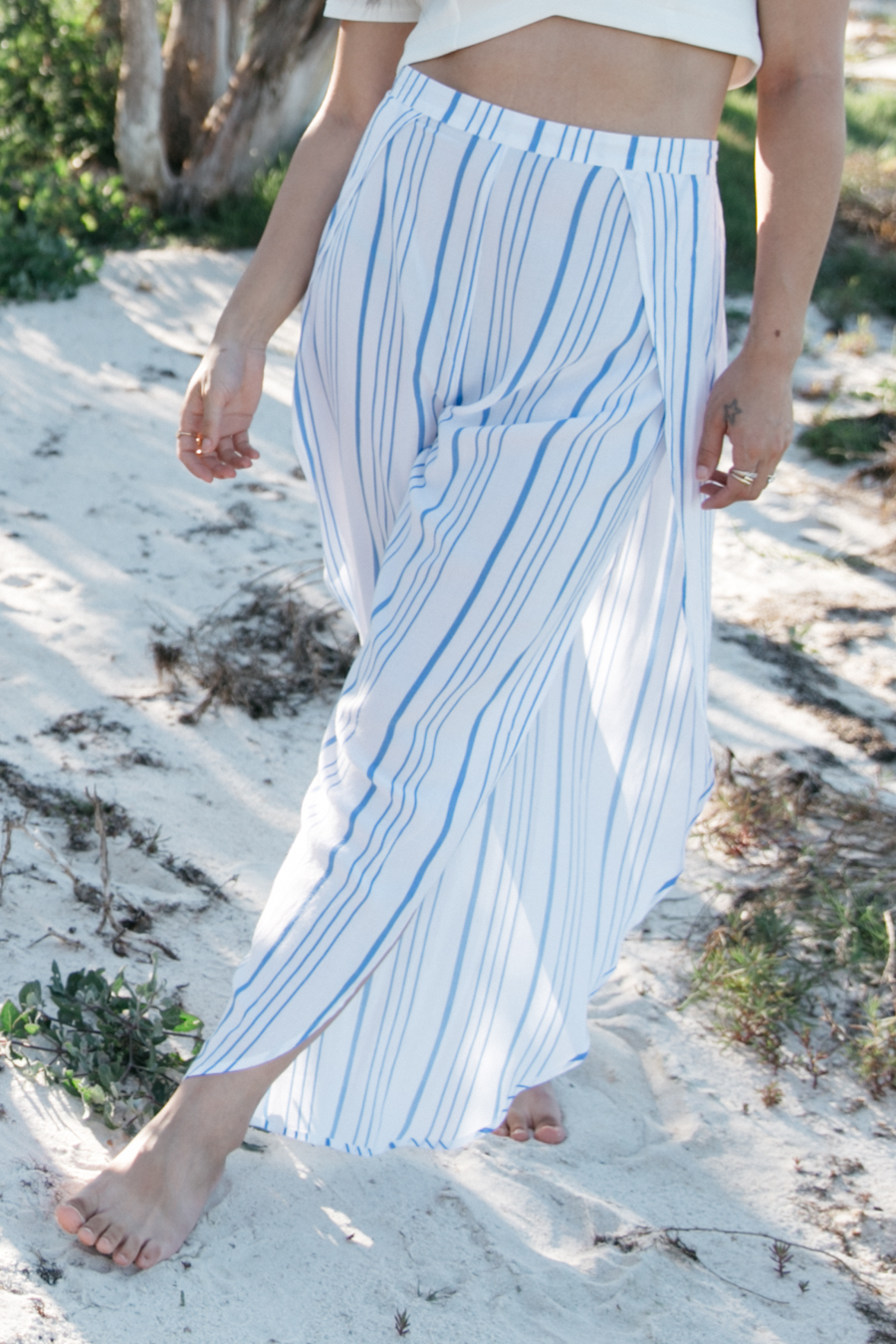 Blue & white vertical striped wide legged pants.