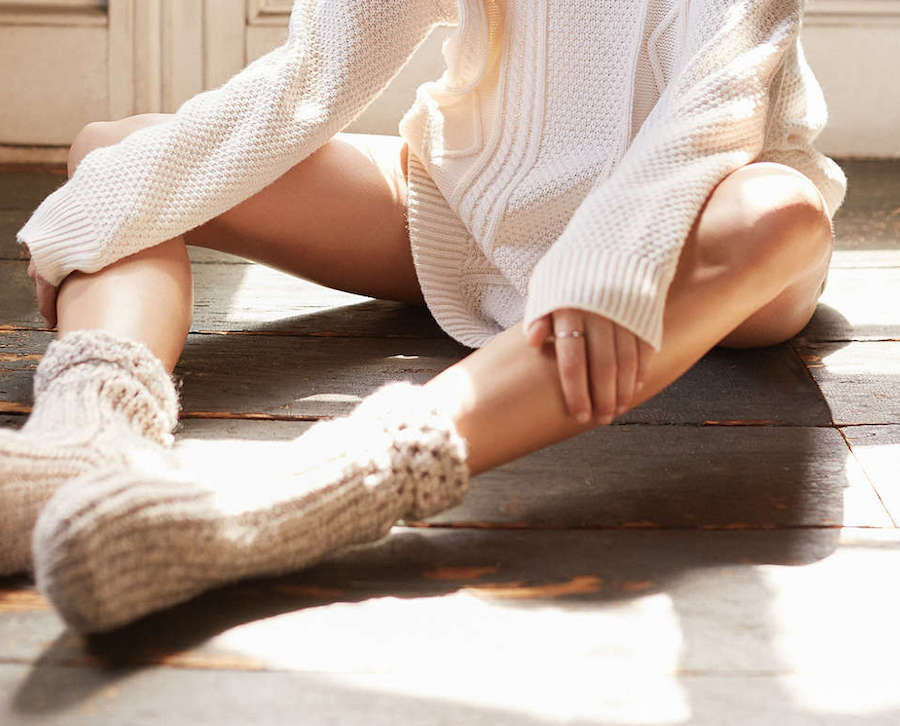 Oversized, white cable knit jumper.