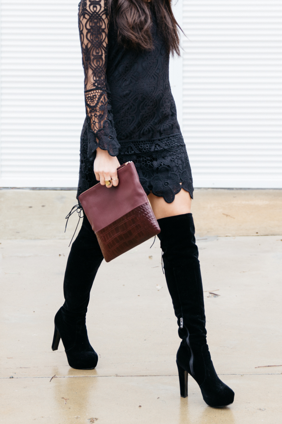 Black lace dress & over the knee boots.
