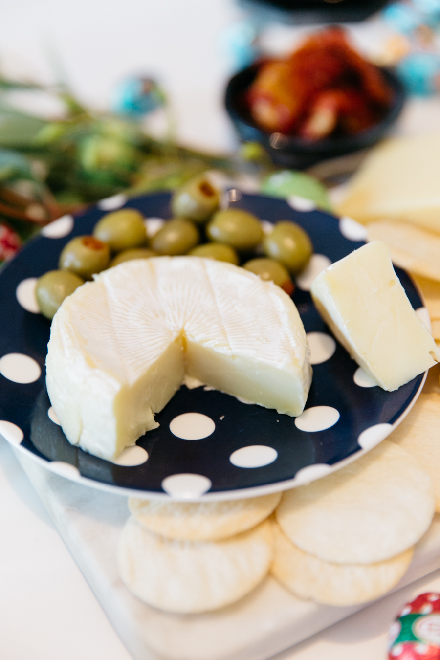 Camembert cheese with stuffed olives.