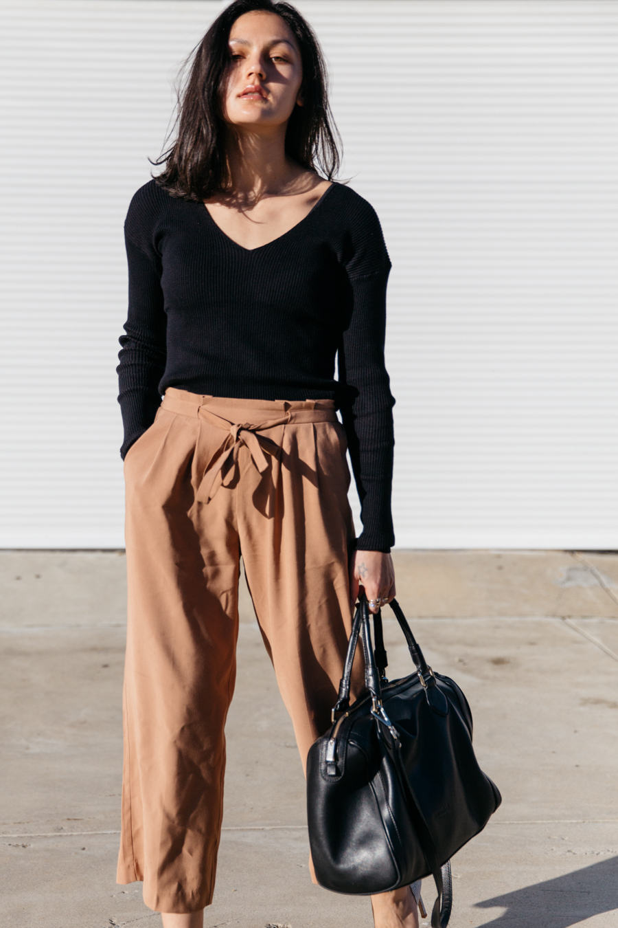 Brown culottes with black long sleeve top.