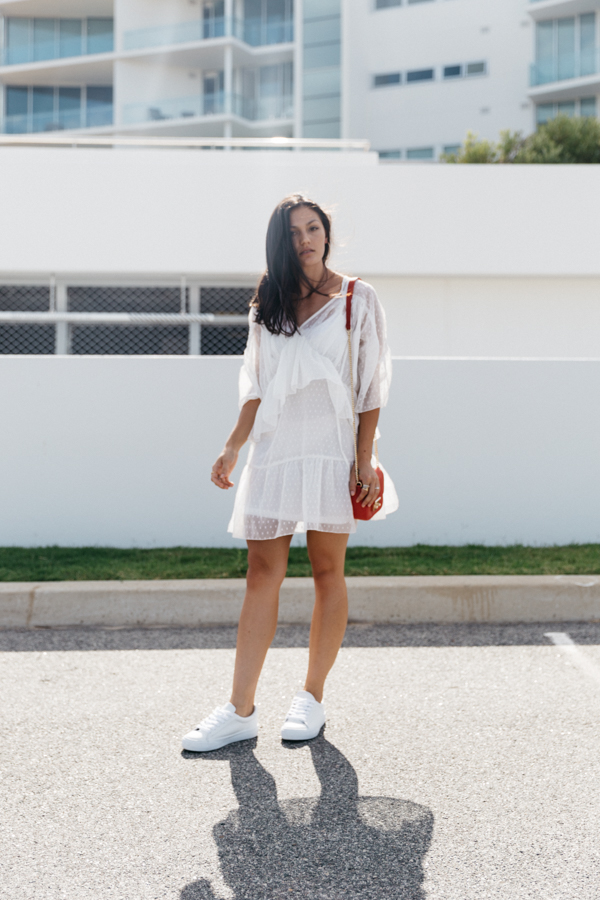White lace swing dress outfit. Summer dress outfit ideas. White dress with sneakers.