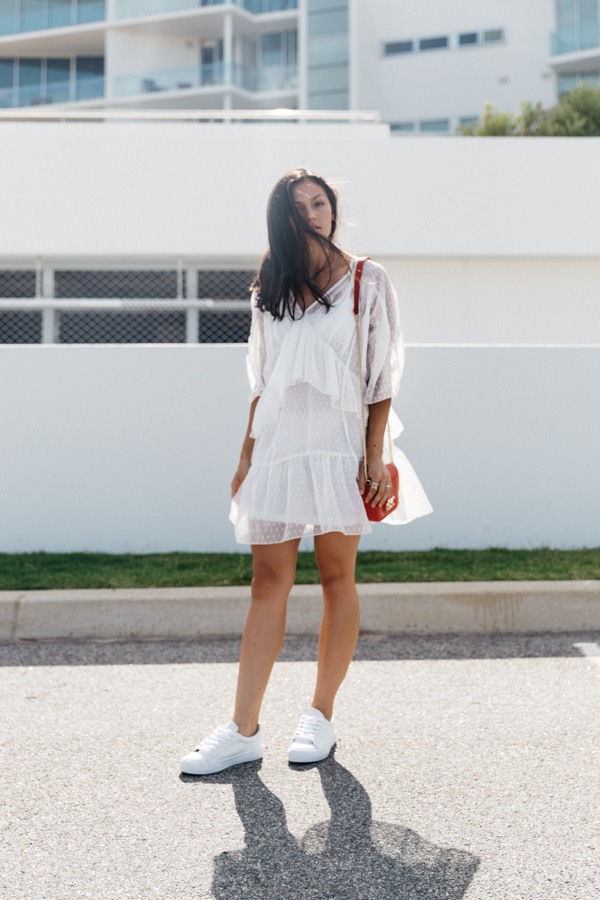 White lace summer dress outfit with sneakers.