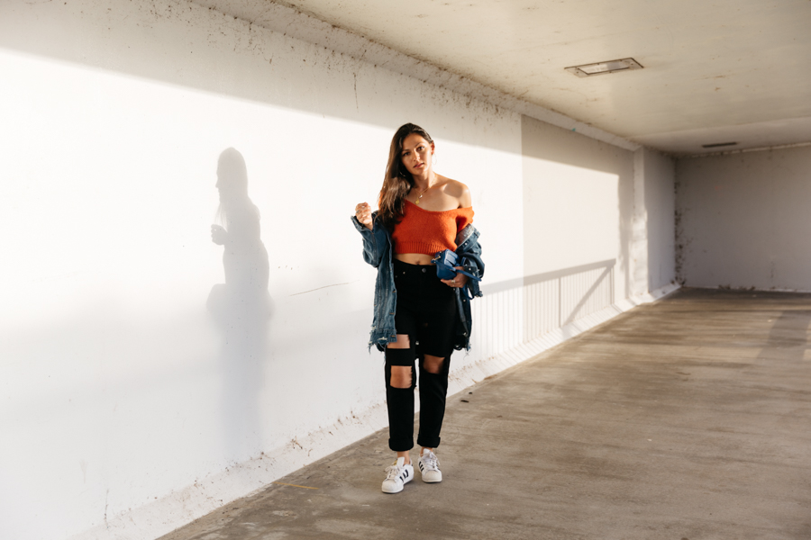 How to wear orange. Orange off the shoulder crop knit sweater with back jeans. Mom jeans outfit.