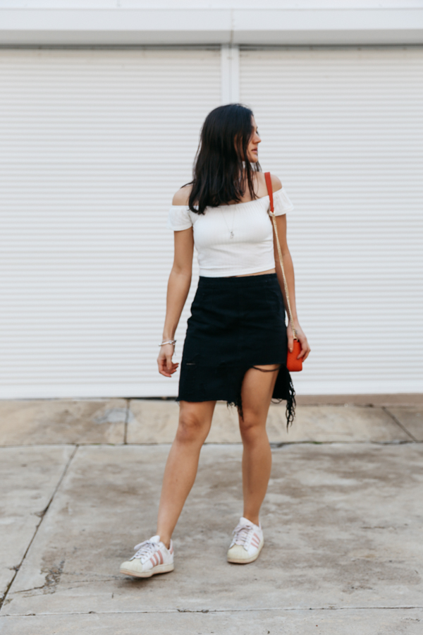 Skirt with trainers outfit.