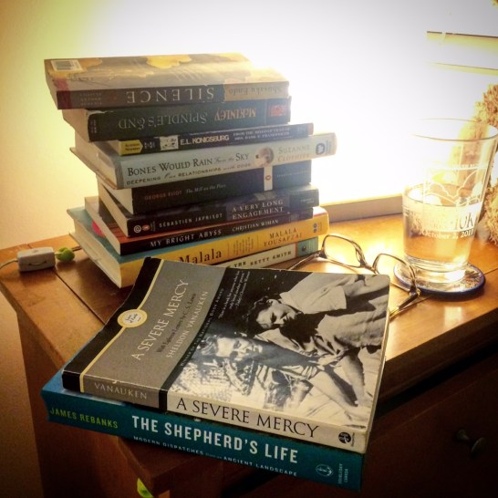 Books currently on my nightstand.