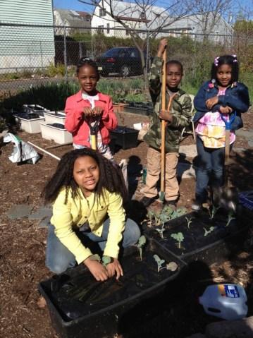 Children gathered at community garden