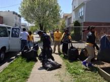 Members of IYO Newark taking away debris