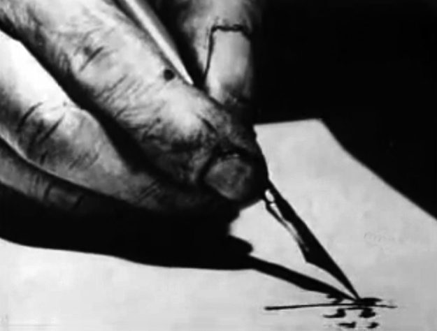 Photo of someone's hand writing on a piece of paper. Courtersy of Wikimedia Commons