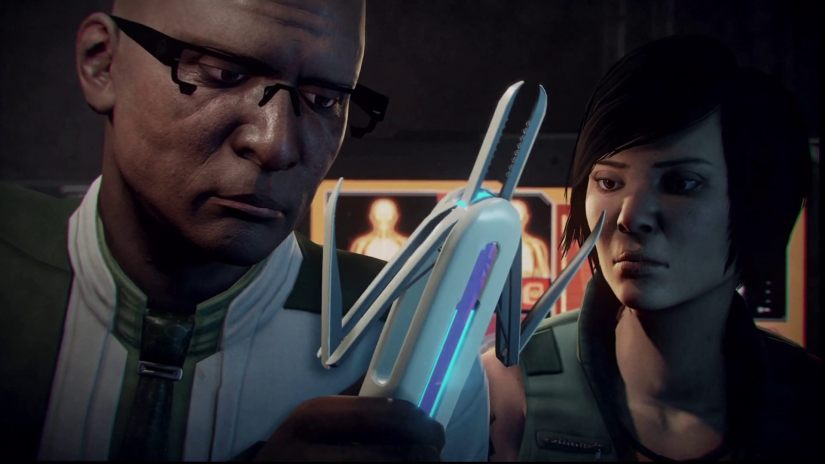 Tygan holding some painful-looking extraction device while Shen looks at it.