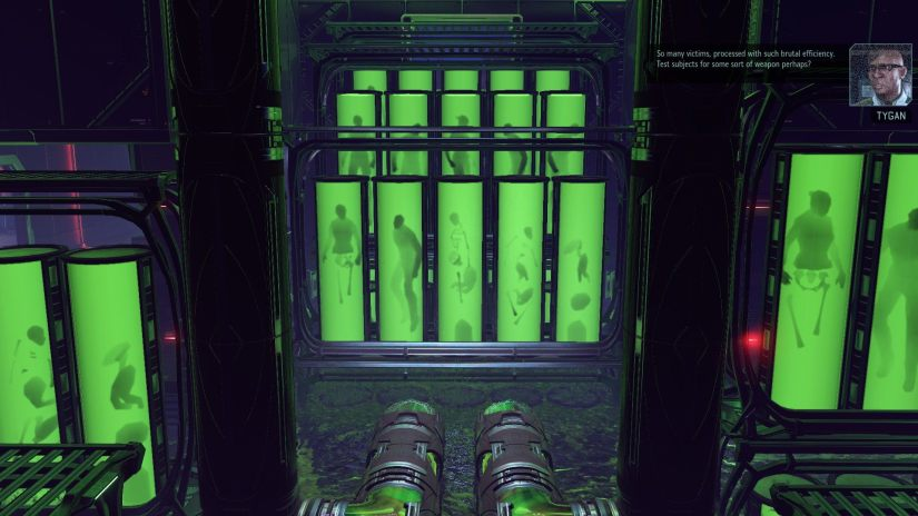 Dozens of tubes containing green liquid and the outline of humans inside.  Tygan then theorizes they may be test subjects for some kind of new weapon.