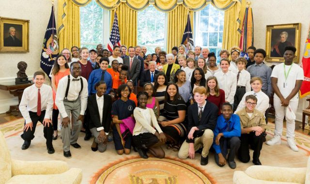 Schoolchildren surrounding President Trump (White House/Shealah Craighead)