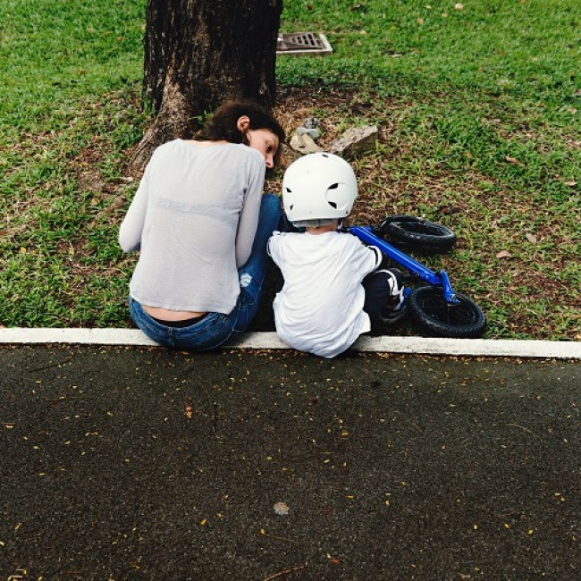 Mom Teaching Son Biking at Park Outdoors