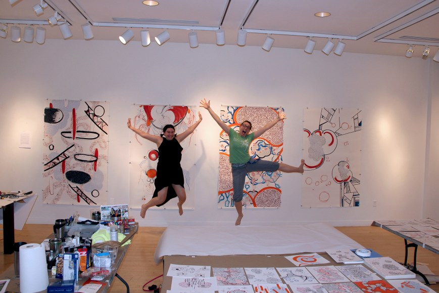 Maria Doering & Fiona Chinkan performing a joyous jump in the studio at the Taplin Gallery