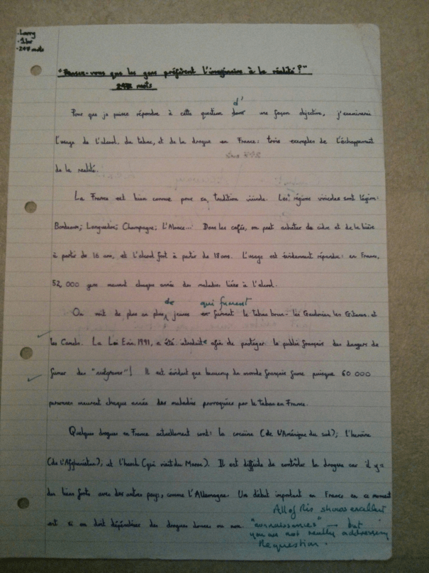 An image of the first marked page of Chris Larham's French A Level philosophical discussion of whether people prefer the Imaginary to Reality [35 out of 45, 2001/2002].