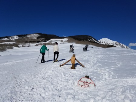 Multi-use family plays on the Snodgrass trail during winter in Crested Butte.