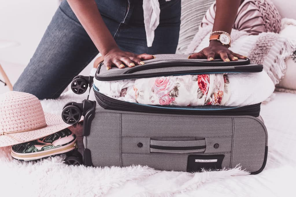 a woman preparing her luggage