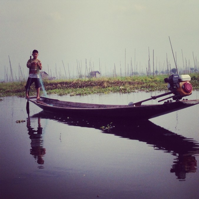 Boy fishing on Inle Lake