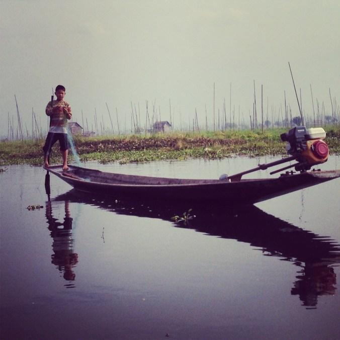 Boy fishing on Inle Lake