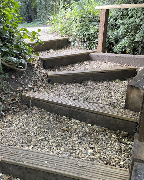 Steps to cross the road on the Pinner to Stanmore country walk