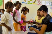 Children receiving a healthy meal.