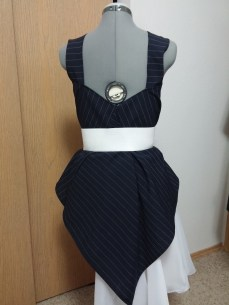 Back View (Reverse): White belt. Check out that high-low hem effect.