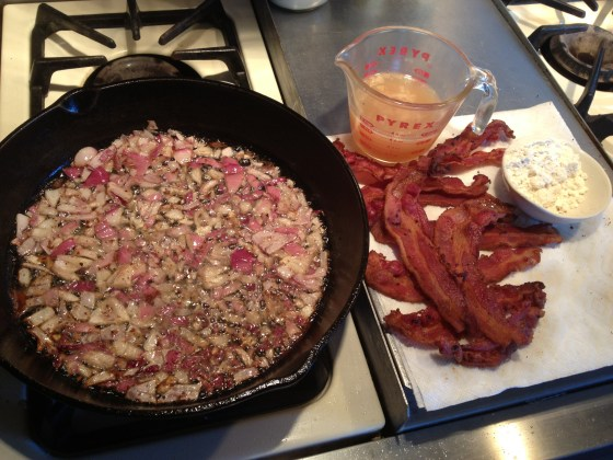 Fry onions in bacon grease