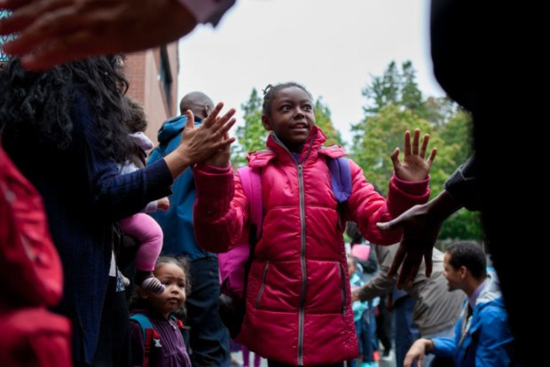 Students at Leschi Elementary School high five men and women of color on Friday, Sept. 25, 2015, as part of #SeattleHigh5. The event aimed to show children of color positive images of black men and women in their community.