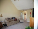 Livingroom view looking toward entry foyer.