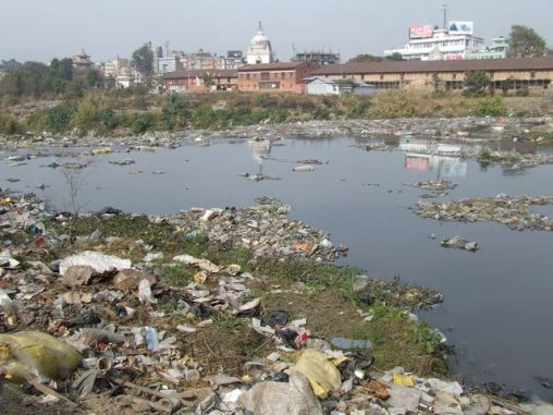 The Bagmati River in a similar state. (http://nepallica.com/wp-content/uploads/2013/06/bagmati-river-pollution.jpg)