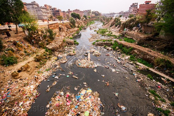 The Bashnumati River filled with garbage that has been improperly disposed of. (http://www.loupiote.com/photos_l/14185711627-plastic-trash-pollution-bishnumati-river-kathmandu-nepal.jpg)