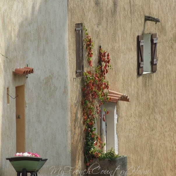 sunshine on the facade of a french house