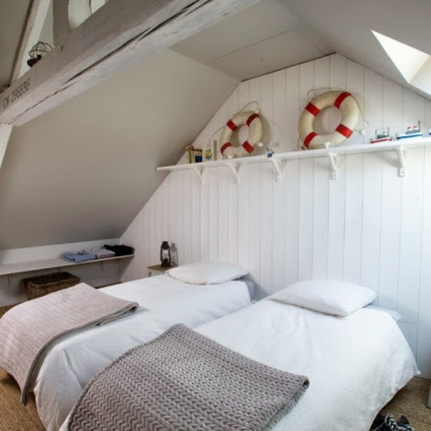 beds with nautical decor on shelves